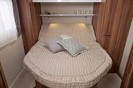 The island bed can be entered from both sides. its the closest in design to a proper double bed